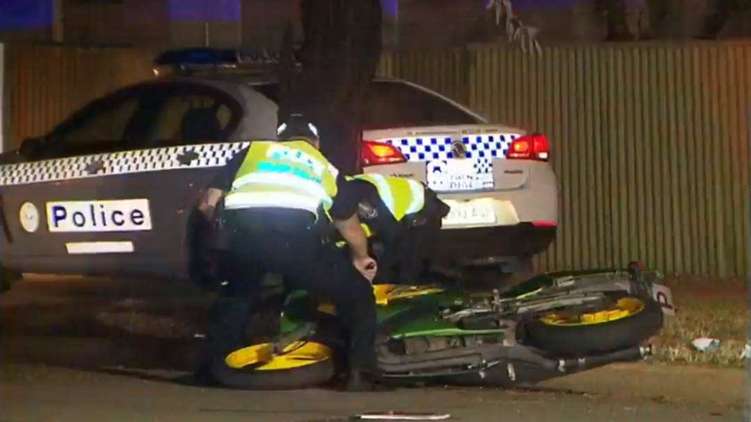 Motorcyclist Run Over By Police Car
