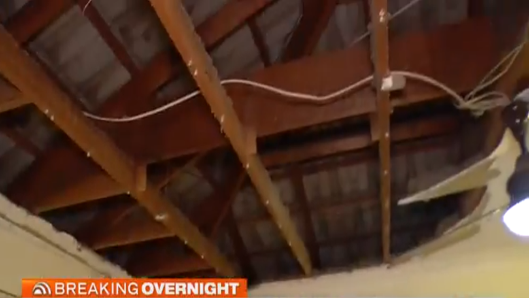 Roof Falls On Couple Watching TV