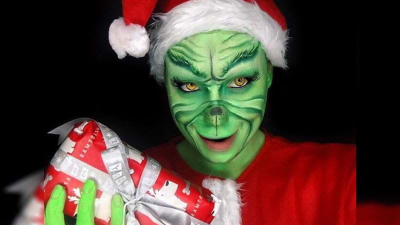 Article heading image for Grinch Makeup Is Now A Thing Because Baubles & Reindeers Just Aren't Enough