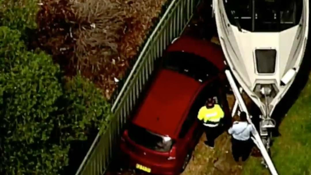 Paramedics Treating Elderly Man After Car Crashed Into Boat In Toongabbie