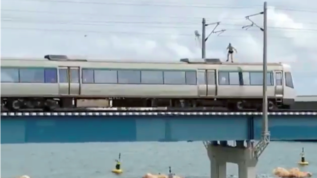 Footage Of Man Train Surfing Before Jumping Off Carriage Into Swan River
