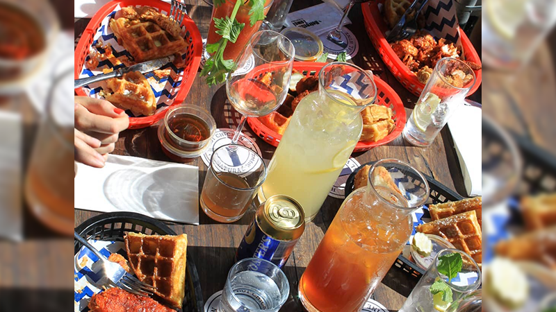 Article heading image for Belles Hot Chicken Is Now Doing Bottomless Brunch W/ Unlimited Cocktail Jugs