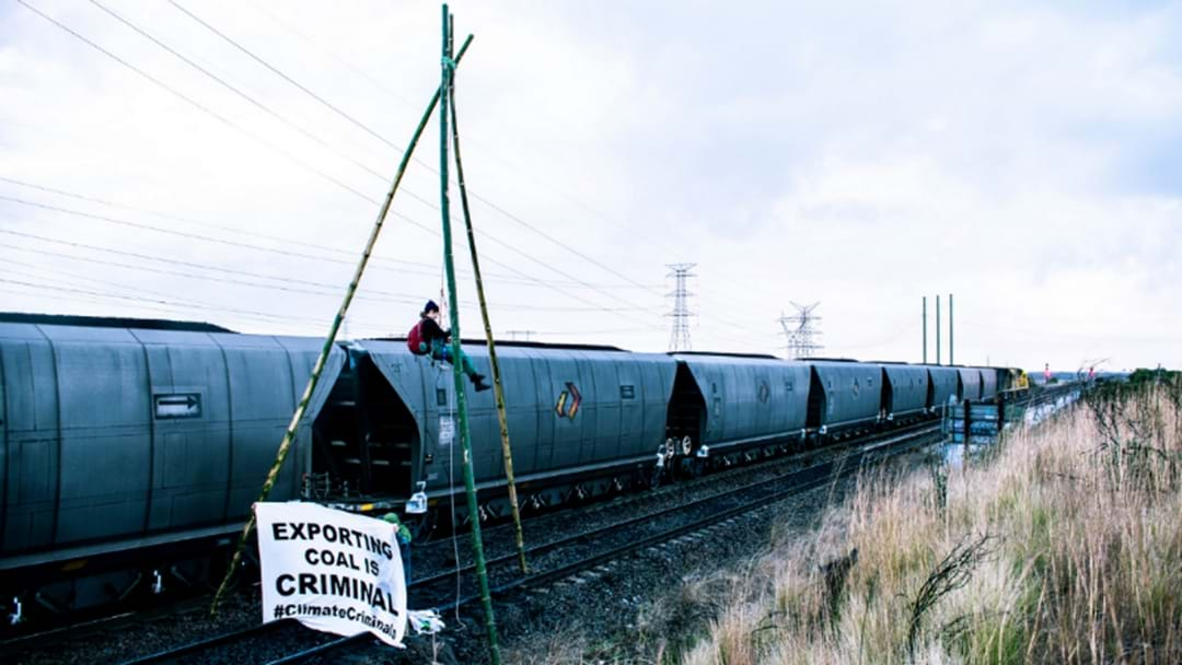 PHOTOS: Anti-Coal Protest Blocks Rail Line