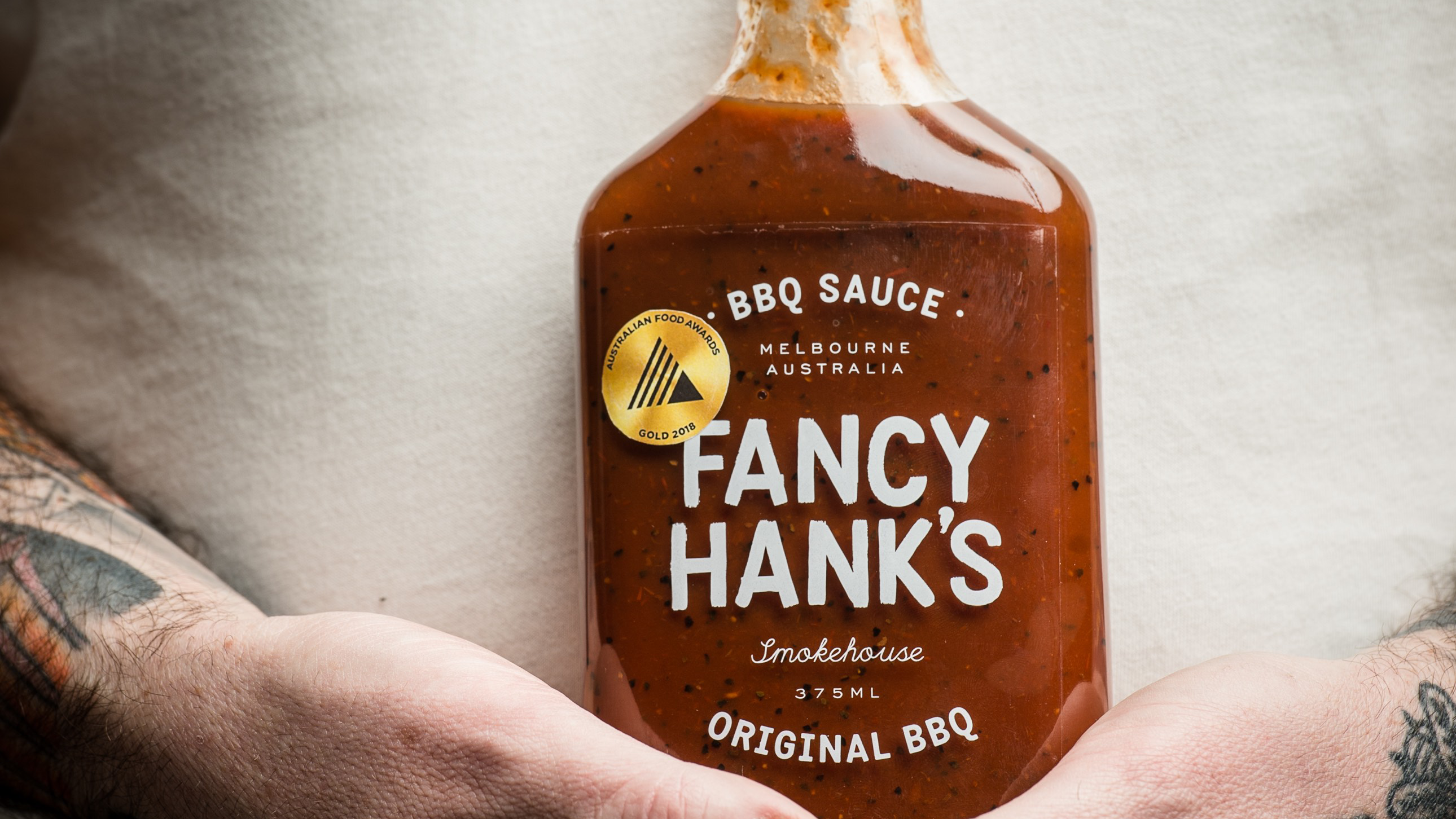 Article heading image for Fancy Hanks Are Now Bottling Their Famous Sauces So You Can Stop Stealing Them
