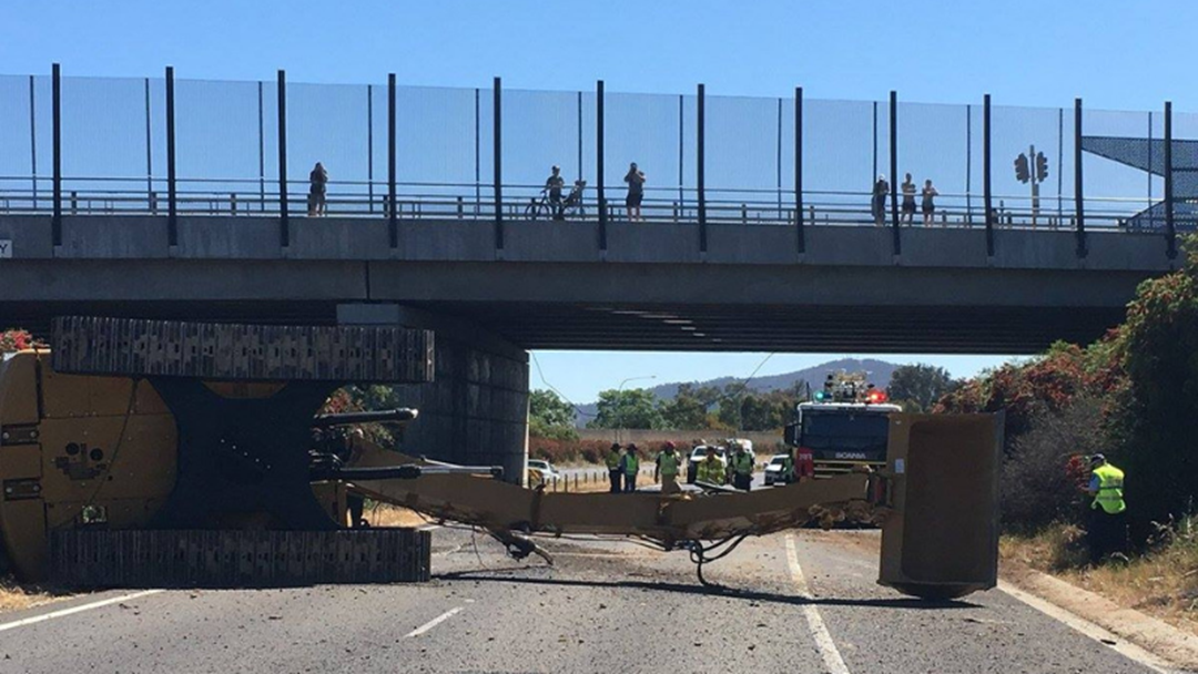 Excavator On Truck Hits Borella Road Overpass On Hume Highway