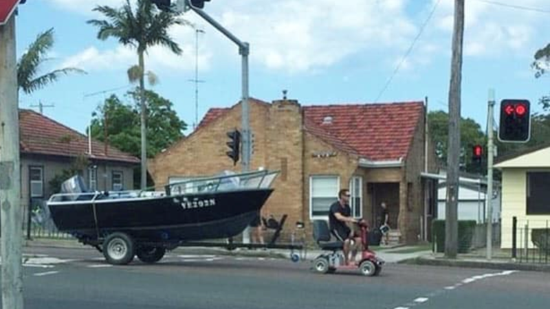 Article heading image for A Man Has Been Charged For Towing His Boat Down The Highway With A Mobility Scooter