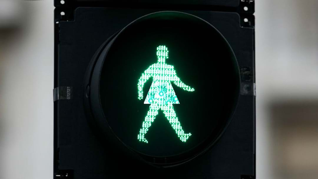 SHOULD PEDESTRIAN CROSSINGS HAVE FEMALE SIGNALS?